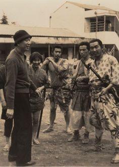 Akira Kurosawa with cast members Keiko Tsushima, Toshirō Mifune, Isao Kimura, and Minoru Chiaki on the set of Seven Samura