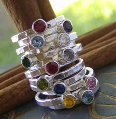 Birthstone gem stacking rings, can be stamped with names of kids on the back.