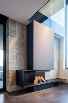 This could be cool with the fireplace below (no hood) and TV above. Or perhaps fireplace to the side and TV adjacent. Showroom - Bosmans Haarden - Fire + places