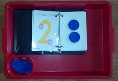 Touch Math: Child counts the dots on the number two and then puts on two chips.