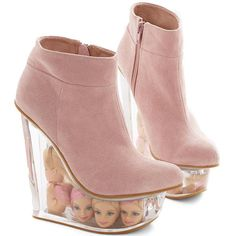 What The Fashion: These Weird Shoes Have Clear Wedges Full Of Barbie Doll Heads (Photos)