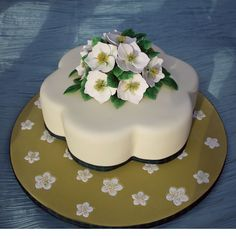 Petal shaped Cake decorated with hand-crafted Christmas Roses. rainbowsugarcraft.co.uk