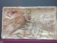This is a crafted marble block Bob sees in the capitolin museum. It belongs to the Mithras cult, it presents the God Mithras killinng a bull by cutting the troat.