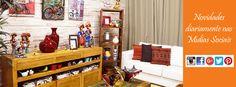 Sala decora com móveis rústicos de madeira de demolição e objetos decorativos da loja Terra Nossa. Com destaque as peças inspiradas no Mestre Vitalino.