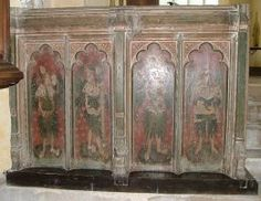 Hitcham screen, north side - The chancel is so grand, some visitors must easily overlook the remains of the rood screen.Only the dado survives,but it is worth a look because instead of saints the panels depict angels holding the instruments of the Passion. Something similar can be seen at Blundeston,and there are also angels on the screen at Southwold.They are very unusual,and,not surprisingly, were vandalised by the 16th century reformers.What is surprising is that they have survived at all.