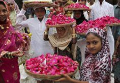 Young indian sufi muslim children carry flower offerings during a visit to the nizamunddin shirne in new delhi - india
