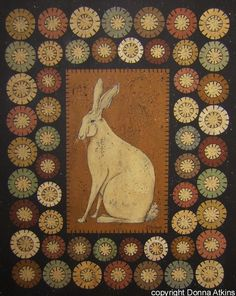 A handsome white hare nicely framed by little moons and stars....