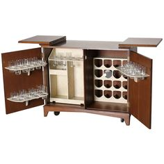 Mid Century Hide-A-Way Dry Bar / Liquor Cabinet | From a unique collection of antique and modern dry bars at http://www.1stdibs.com/furniture/storage-case-pieces/dry-bars/