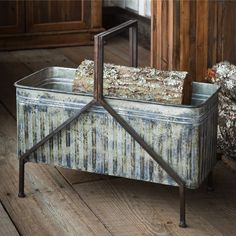 Our Iron Bucket Metal Firewood Holder will hold your firewood and keep your hearth area tidy. Visit Antique Farmhouse for more firewood boxes! Log Home Decorating, Farmhouse Style Decorating, Farmhouse Decor, Farmhouse Ideas, Decorating Games, Firewood Storage, Firewood Holder Indoor, Firewood Stand, Firewood Basket
