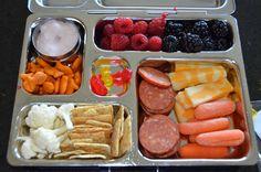 Yogurt, Pizza goldfish, cauliflower, wheat thins, pepperoni, carrots, cheese, blackberries, raspberries & gummy bears