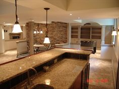 Spaces are created by soffits, half walls, and columns. Arched drywall pockets and built in's. Wood panel, cherry bar with granite top
