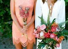 Stunning Spring Wedding Bouquets | Deep greens, bright pinks, and blood oranges come together to create this jungle tropical wedding. The eclectic contrast of simple roses and peonies with tropical buds, green palms, and even pineapples, melds classic and exotic. The bridesmaid bouquet of unripe pineapples is a simple yet striking complement.