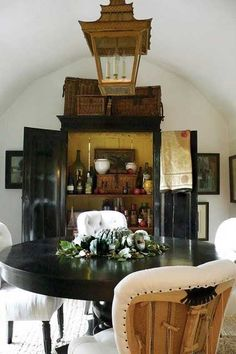 I'd probably go with a different light fixture and chairs, but love the round, dark wood pedestal table and cabinet Black Rooms, Black Walls, British Colonial Decor, French Colonial, Armoire Makeover, Yellow Interior, Vogue Living, Black Furniture, Painted Furniture