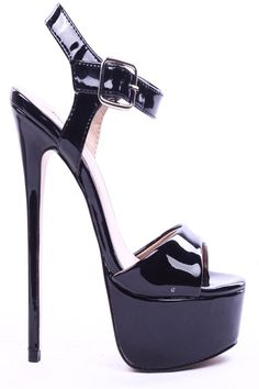 Patent faux leather upper in a dress sandal heel style with a round open toe, ankle strap with adjustable buckle closure. Faux leather lining and footbed. 6 1/2 inch heels.