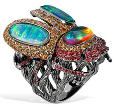 Lydia Courteille. Scarab ring, rubies, orange sapphires and opals, blackened gold. Picture c/o The Jewellery Editor.
