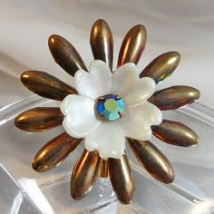 This #vintage flower brooch is just so gorgeous!  It features a daisy style brooch with multiple thin petals that have been coated with a rainbow anodized metal coating.  Th... #ecochic #etsy #jewelry #jewellery