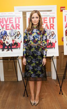 """Rose Byrne in at long-sleeved, multicolored floral Erdem dress with chiffon inserts with silver Jimmy Choo heels at """"I Give It A Year"""" screening"""