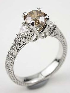 Antique Style Champagne Diamond Engagement Ring    Beautiful filigree and trillian cut diamonds make champagne diamond engagement rings like this one irresistible. #scoresense