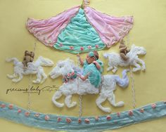 Newborn baby girl riding on horse in carousel. Pink mint green gold flowers beautiful brilliant funny adorable unique Precious Baby Photography Baby ImaginArt by Angela Forker