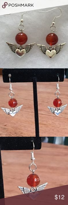 Red Carnelian Heart Angel Wings Earrings These beautiful earrings are made with natural carnelian. The heart charms are silver tone and the hooks are sterling silver plated.   All PeaceFrog jewelry items are handmade by me! Take a look through my boutique for more unique creations. PeaceFrog Jewelry Earrings