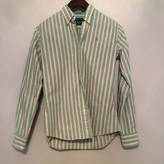 A Ralph Lauren Button Down A green, yellow, and pink Ralph Lauren button down top. Perfect for spring! EUC. Ralph Lauren Tops Button Down Shirts