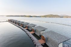 Perched on the Srinakarin Dam in Kanchanaburi, Thailand, in the middle of the valley, the Resort establishes a new high-water mark in floating luxury. The award-wining floating resort has a nature-oriented design and offers private on-the-ground a Floating Hotel, Floating Deck, Bungalow Resorts, Studio 57, Floating Architecture, Water Villa, Hotel Concept, Visit Thailand, Installation Art