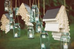 book chandeliers + hanging mason jar candles.