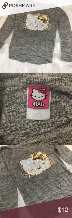 Little Girls Hello Kitty Sequin Sweater Cute Hello Kitty Sequin Sweater. Sweater is grey with gold shimmer. On the front is Hello Kitty design with white & gold sequins! Hello Kitty Shirts & Tops Sweaters