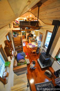 """The living space has a custom built couch with storage and a high end gas stove. The dining area has a beetle kill tabletop with a 16"""" folding leaf, providing enough space for a family of four."""