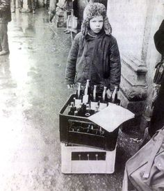 """After the fall of the Soviet Union... Young boy selling Pepsi on a Moscow street"", 1993"