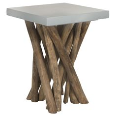 Juxtaposing legs of reclaimed teak branches and a sleek modern light grey top, the Hartwick side table is truly transitional.