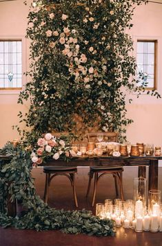 a super lush greenery and blush blooms reception backdrop plus a table runner and lots of candles - Weddingomania Flower Wall Wedding, Wedding Wall, Wedding Flower Arrangements, Floral Wedding, Wedding Colors, Wedding Flowers, Table Wedding, Wedding Themes, Diy Wedding