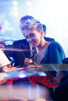 Scarlett Johansson signs autograph for fans at the World Premiere of the Paramount Pictures release 'Ghost In The Shell' at TOHO Cinemas Shinjuku on March 16, 2017 in Tokyo, Japan.