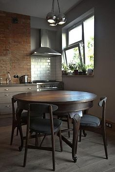Eat In Kitchen With Vintage Table Exposed Brick Walls With Contemporary  Kitchen Cabinets, Tile,