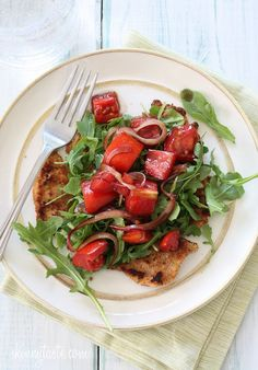 Breaded chicken cutlets, baked in the oven topped with arugula, tomatoes and balsamic.