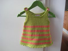 Green striped knitted sleeveless babydress for a baby. $30  http://www.etsy.com/listing/91239317/green-striped-knitted-sleeveless