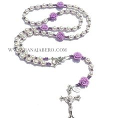 This simple, yet elegant Rosary features 6mm off-white pearls with light purple colored roses for the Our Father beads, along with purple seed beads in between