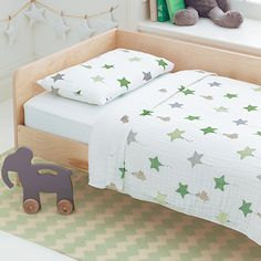 Sleeping under the stars...Toddler bed set (blanket, sheet, pillow case) made of very soft cotton by @AdenandAnais.