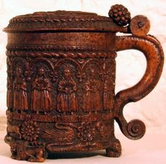 The Glastonbury Grace Cup, a 16th century oak tankard intricately carved with images of the 12 Apostles, the crucifixion of Christ, birds, beasts and flowers