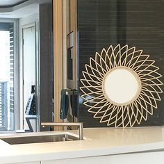 A bamboo mirror in a contemporary style kitchen. Why not? Mixing styles is fun!