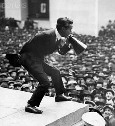 Charlie Chaplin addressing crowds via megaphone on the steps of Sub-treasury Building in New York during World War I third Liberty Loan Rally in 1917.