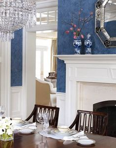 Clean and Crisp Dining Room  Designed by Allison Caccoma, this beautiful, traditional dining room creates a dramatic contrast thanks to the creamy white moldings juxtaposed against the Prussian blue Venetian plaster walls. (Photo: John Valiant)