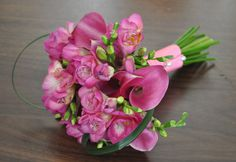 Pink mini callas with pink freesia for a little girl.