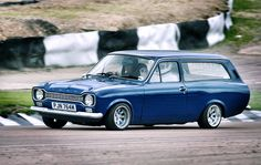 Ford MK1 Escort Estate my first car i ever bought after passing driving test 200 pounds and full of filler lol