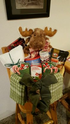 Moose Christmas Family Basket. Something for everyone. coffee, cocoa, nuts, cookies, tea, mugs, candy canes, dish towels and a fun stuffed moose.