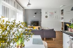 Modern boho interior, inspired by Kate Moss, is a beautiful mix of light and wood surfaces, cheerful spring colors, gray shades, geometric patterns and textures