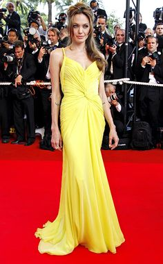 Best: Angelina JolieWhen Angelina Jolie joined Brad Pitt, at Cannes, for the 2007 premiere of his film Ocean's Thirteen, the actress stole the spotlight in her canary yellow Emanuel Ungaro dress.Comments 4Image Credit: BENAINOUS/HOUNSFIELD/LEGRAND/Getty Images