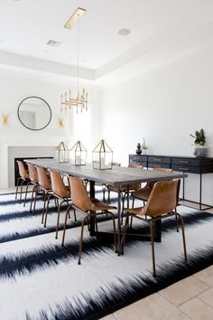 awesome Salle à manger - Extra long dining room table, leather school house chairs, and brass chandelier:...