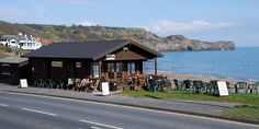 Sandside Cafe, Sandsend, North Yorkshire. Basically a hut behind the beach serving snacks and homemade cakes. Fabulous