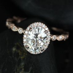 "The vintage-inspired ""Gwen"" ring, from Rosados Box on Etsy, puts the spotlight on moissanite and diamonds and is set in 14k rose gold."